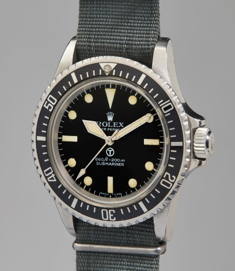 An extremely rare and well-preserved stainless steel military wristwatch with revolving bezel, fixed bar lugs and military engravings made for the British Royal Navy, accompanied with original owners Royal Navy Divers log and knife