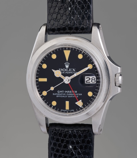An iconic, historically important, and remarkably well-preserved stainless steel dual-time wristwatch with date