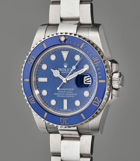 A very fine, heavy, and commanding white gold diver's wristwatch with blue ceramic bezel, date, bracelet, accessories, and original hang tag