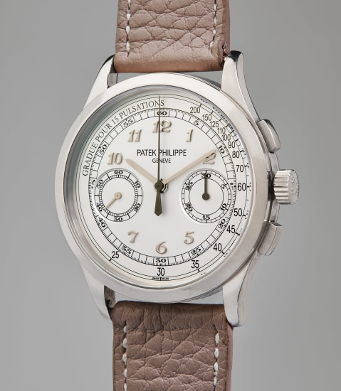 A rare and attractive white gold chronograph wristwatch with pulsometer scale, original certificate, and presentation box