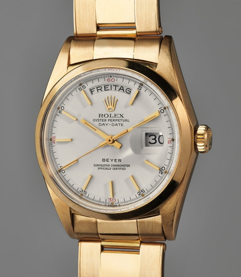 A rare and fine yellow gold calendar wristwatch with smooth bezel and bracelet, retailed by Beyer
