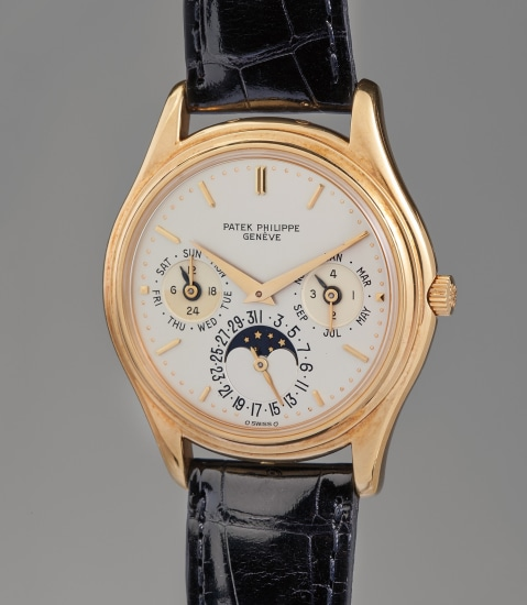 """An attractive and fine """"first series"""" yellow gold perpetual calendar wristwatch with moon phase"""