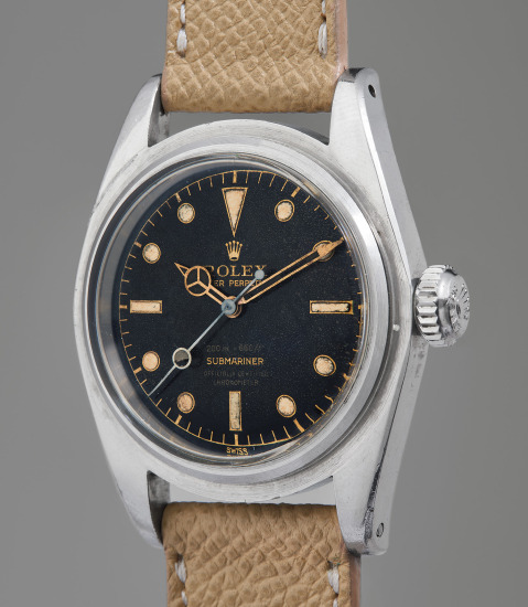 "A very fine, rare, and interesting stainless steel diver's wristwatch with glossy ""four-liner"" dial and oversized crown"