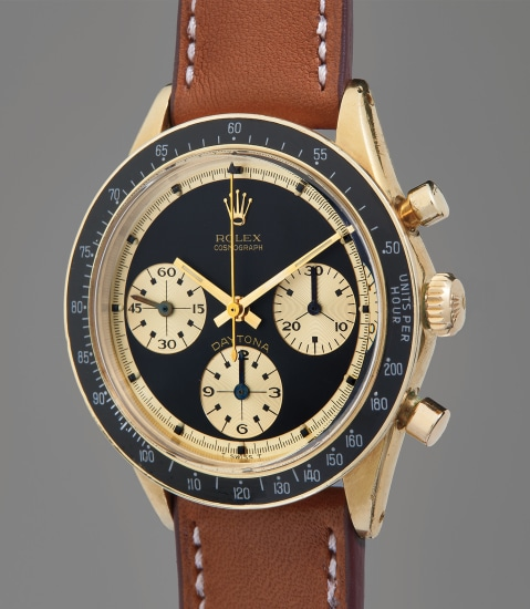 "A very fine, well-preserved, and highly attractive yellow gold chronograph wristwatch with ""Paul Newman"" dial and original guarantee"