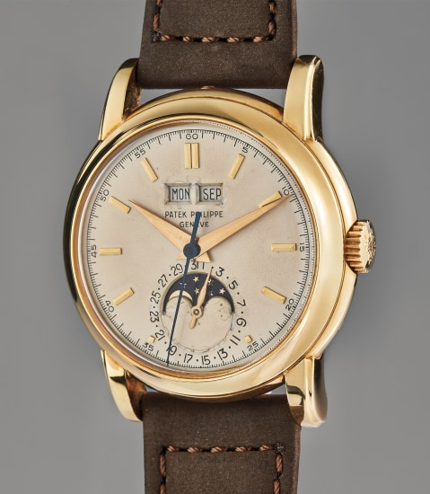 A very rare, well-preserved, and important yellow gold perpetual calendar wristwatch with moon phase, center seconds and screw-back case