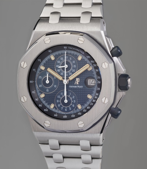 An early and very rare stainless steel chronograph wristwatch with date, tachymeter scale, and blue tapisserie dial