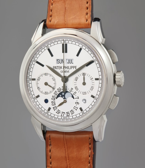 A very fine and rare white gold perpetual calendar chronograph wristwatch with moonphase, leap year, and day/night indicator, additional case back, original Certificate of Origin, and fitted presentation box