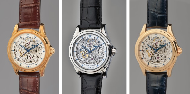 A very rare and important limited edition set of three gold Co-Axial skeletonized chronometer wristwatches, each with an international guarantee, Chronometer Certificate, accompanied with an Omega Certificate of Authenticity, letter from George Daniels