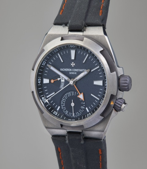 A unique and attractive titanium and tantalum anti-magnetic dual-time wristwatch with day/night indicator, central seconds, and date, worn by Cory Richards on Mount Everest with proceeds going to charity