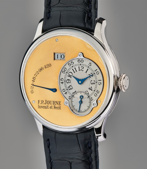 An extremely rare, very early, and exceptional platinum automatic wristwatch with asymmetric hour and minute display, large date aperture, and power reserve, with gold dial and brass movement