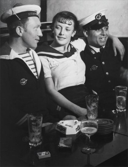 Conchita with sailors in a café on the Place d'Italie