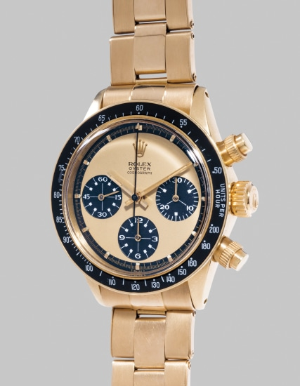 """An exceedingly rare, highly important and very attractive yellow gold chronograph wristwatch with """"lemon"""" grené dial, white graphics and bracelet"""