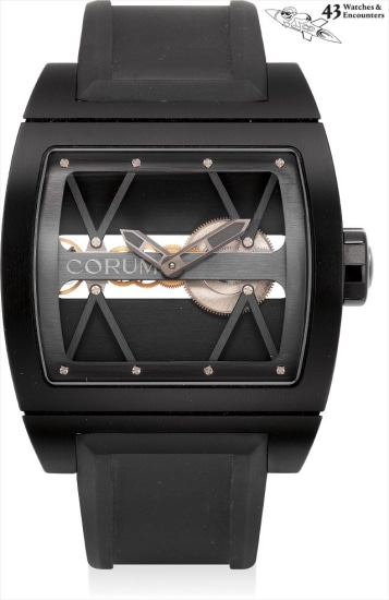 Laurent Picciotto Collection: A black PVD-coated titanium skeletonised tonneau-shaped wristwatch with speakers and leather travel bag, numbered 1 of a limited edition 250 pieces