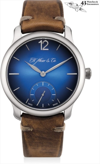 Laurent Picciotto Collection: A fine and unique white gold prototype wristwatch with special blue dial and cap