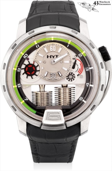 Laurent Picciotto Collection: A fine and rare titanium semi-skeletonised wristwatch with retrograde fluid hours, power reserve, HYT windbreaker, power pack, football and USB, numbered 1 of the first piece produced