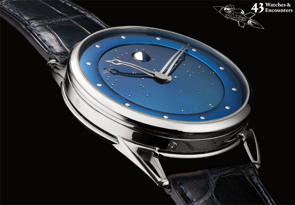 Laurent Picciotto Collection: A fine and unique white gold wristwatch with spherical moon phases, power reserve, customised constellation of Laurent Picciotto's hometown, samples of the study used for the secret signature on the dial and framed photograph