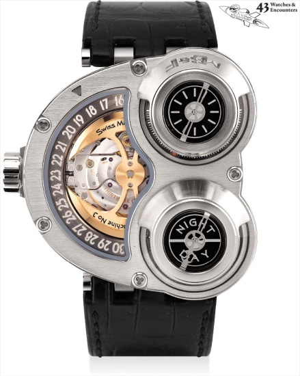 Laurent Picciotto Collection: A fine, rare and unusual titanium and white gold three-dimensional wristwatch with inverted movement, date ring, day and night indicator, tee shirt, original certificate and fitted presentation box