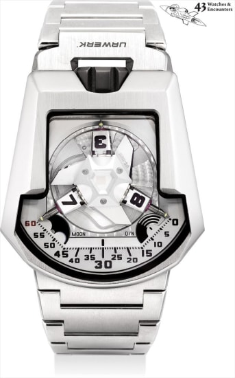 Laurent Picciotto Collection: A very rare, large and unusual stainless steel and titanium special edition three-dimensional satellite hour display, telescopic minute hand, twin turbin winding system, moon phases, day and night indicator, large poster, sketch of UR-202 and framed photograph of front and back of the watch, numbered 1 of a limited edition of 12 pieces