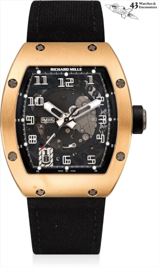 Laurent Picciotto Collection: A fine and rare pink gold skeletonised tonneau-shaped wristwatch with sweep centre seconds, date, golf balls, book and framed photographs, the 'Mille' Mille
