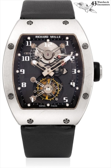 Laurent Picciotto Collection: A fine and very rare white gold tonneau-shaped tourbillon wristwatch with power reserve, torque indicator, framed photograph and golf balls