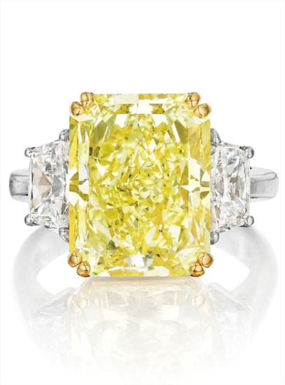 A Magnificent Fancy Yellow Diamond and Diamond Ring, Cartier