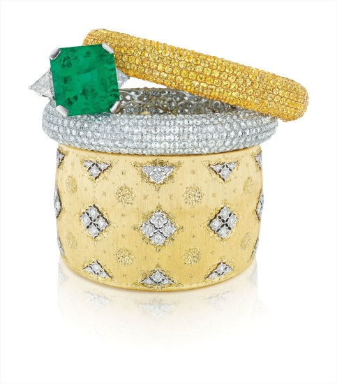 A Superb Colombian Emerald and Diamond Ring; An Impressive Set of Diamond and Yellow Sapphire Bangle Bracelets; and A Gold and Diamond Cuff, Buccellati