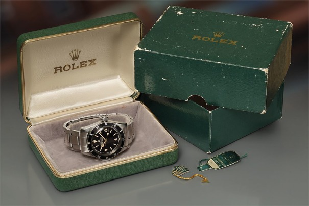 An extremely rare, important, and early stainless steel wristwatch with black glossy Explorer dial, gilt hands, presentation box, and hangtags.