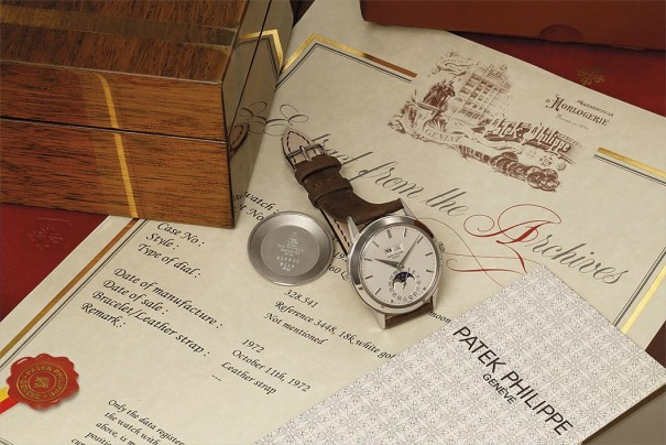 An exceptional, rare, and well‐preserved white gold perpetual calendar wristwatch with moon phase indication, and rare reversed date dial, original literature, and presentation box.