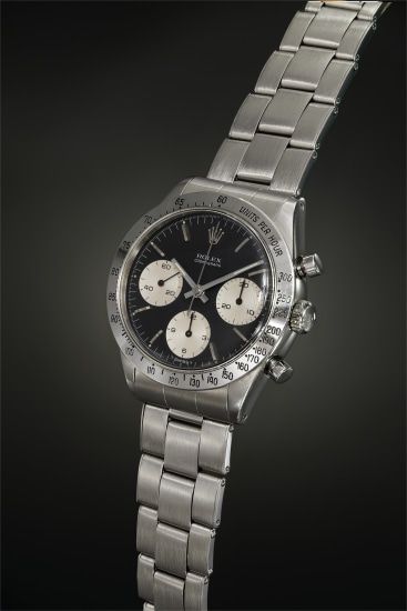 A well-preserved and early stainless steel chronograph wristwatch with extremely rare black and white dial configuration, tachymeter bezel and bracelet