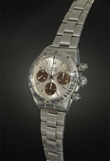 An extraordinarily well-preserved stainless steel chronograph wristwatch with silvered dial displaying chocolate 'tropical' registers and bracelet.