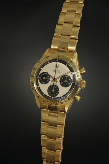 A very rare and extremely well-preserved yellow gold chronograph wristwatch with champagne 'Paul Newman' dial, factory sticker, tachymeter bezel and bracelet