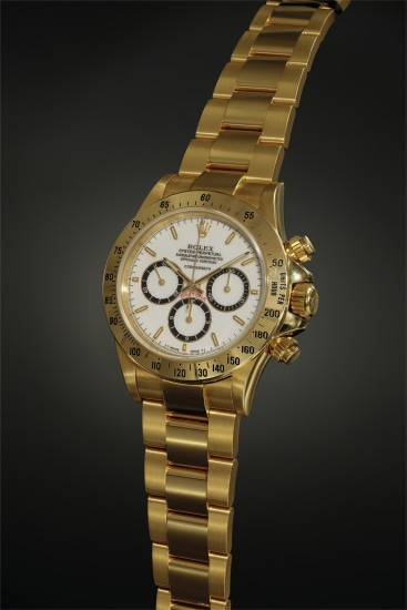 A rare, early and well-preserved yellow gold chronograph wristwatch with so-called 'porcelain' dial displaying 'floating' logo, guarantee, bracelet and fitted presentation box