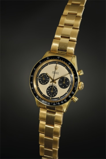 A rare, beautiful and well-preserved yellow gold chronograph wristwatch with champagne 'Paul Newman' dial and bracelet