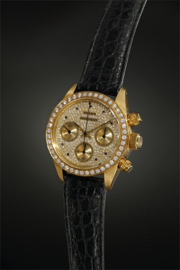 An exceedingly exclusive and lavish diamond and sapphire-set yellow gold chronograph wristwatch, made for the French market