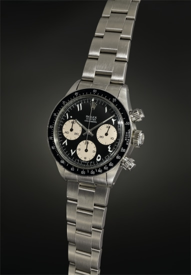An exquisite, important and most probably unique chronograph wristwatch with black dial displaying white Arabic-Indic numerals, and bracelet