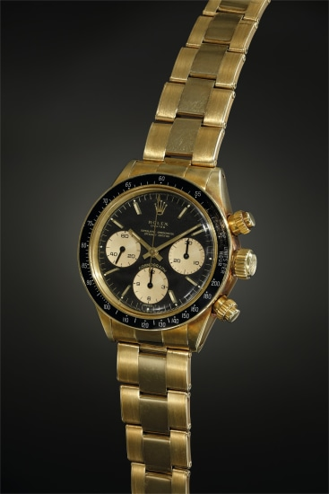 A highly rare and well-preserved 14K yellow gold chronograph wristwatch with black dial displaying small 'Oyster' designation and 'floating scripts'