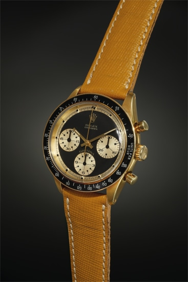 An exceedingly rare and outstandingly beautiful yellow gold chronograph wristwatch with black 'Paul Newman' dial displaying contrasting gold registers