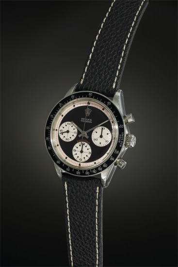 A highly rare and exceptionally well-preserved stainless steel chronograph wristwatch with black 'Paul Newman' dial, tachymeter bezel and bracelet