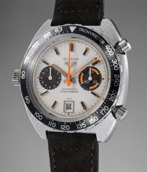 A very attractive and rare stainless steel chronograph wristwatch with orange accents on a white dial