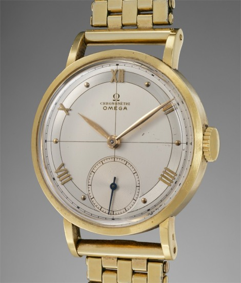 A rare and remarkably well-preserved yellow gold wristwatch with two-tone dial, bracelet and original certificate