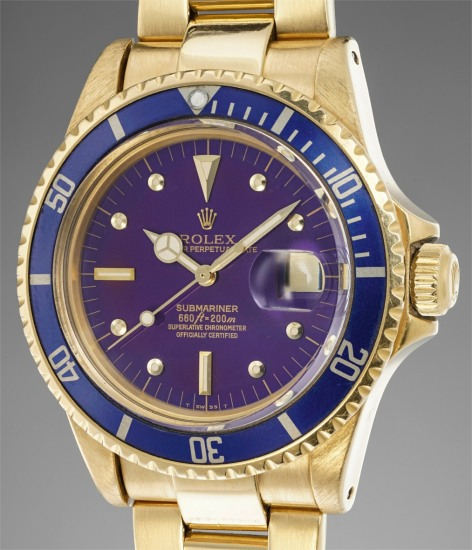 "A rare and very attractive yellow gold diver's wristwatch with date, blue bezel, purple ""tropical"" dial and bracelet"