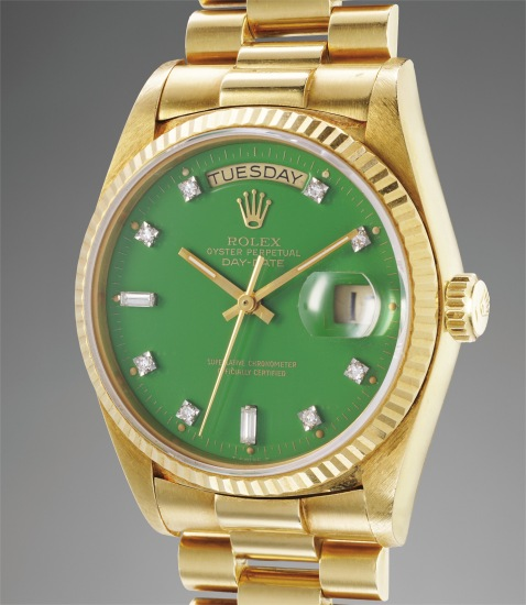 A rare and attractive yellow gold calendar wristwatch with green lacquer dial and bracelet