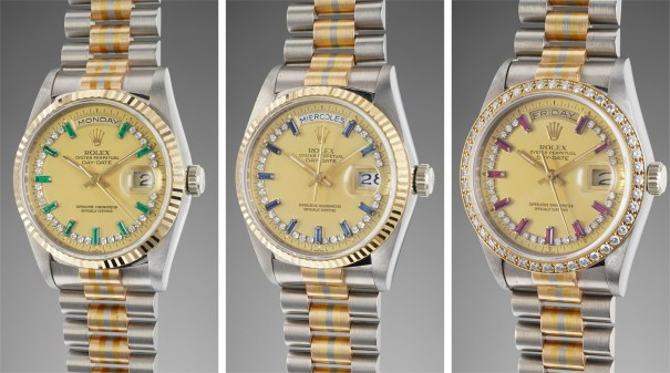 A set of three rare and attractive yellow gold, diamond, emerald, sapphire and ruby set calendar wristwatches with tridor bracelet, centre seconds and champagne dial