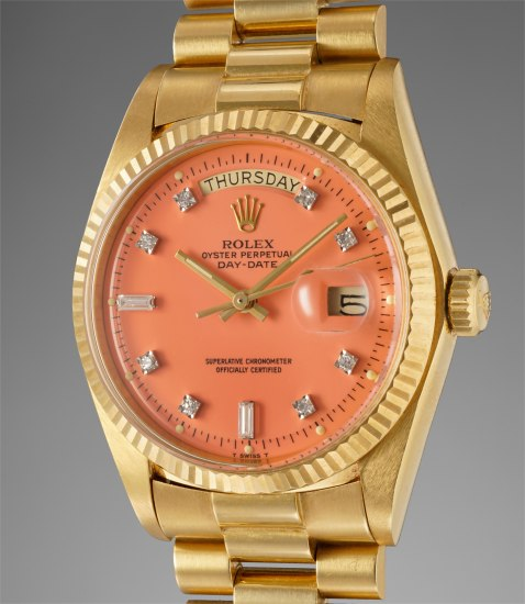 """A very rare and attractive yellow gold calendar wristwatch with coral colored lacquer """"Stella"""" dial and bracelet"""