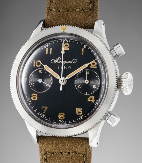A very rare, attractive and historically important stainless steel flyback chronograph wristwatch with black glossy dial