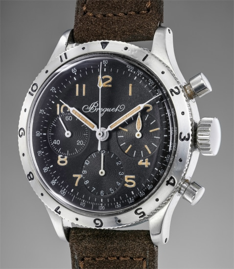 A very fine and extremely rare stainless steel flyback chronograph wristwatch with tachymeter scale
