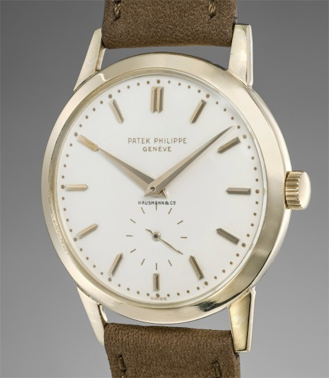An attractive and extremely rare yellow gold wristwatch with enamel dial retailed by Hausmann & Co