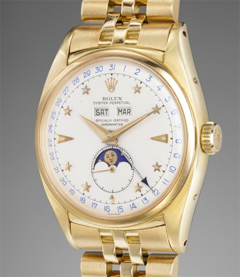 An extremely fine, rare and important yellow gold triple calendar wristwatch with star-set numerals, moonphases and bracelet
