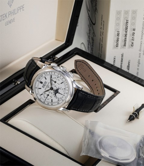 A fine and rare white gold perpetual calendar chronograph wristwatch with moonphases, additional case back, original certificate and fitted presentation box
