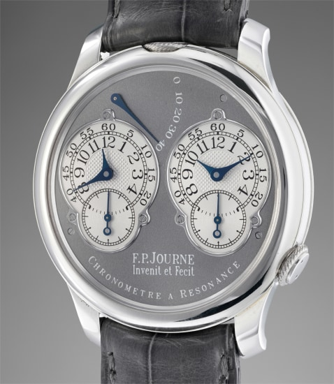 A fine and rare limited edition platinum dual time wristwatch with double escapement